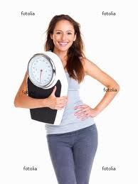 happy woman with weight scale